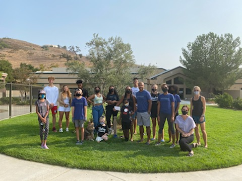 Oak Park families gather in front of the Luc Bodden Tree located at the entrance of Red Oak Elementary School on Luc Bodden Day.