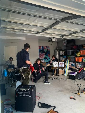 """Pictured: Jaden Blank on guitar, Logan Postmus on bass, Liam Case on saxophone and Bob Emrich on drums. Members are jamming to their single """"Say So."""""""