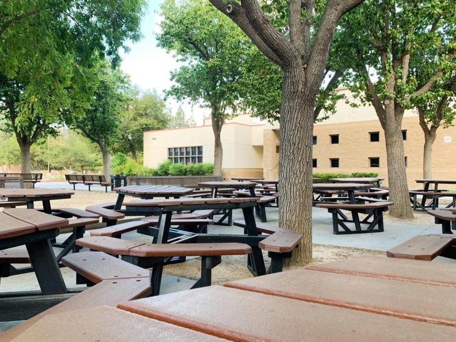 Lunch tables cover the areas surrounding the sophomore lockers, yet there are no students around to sit.