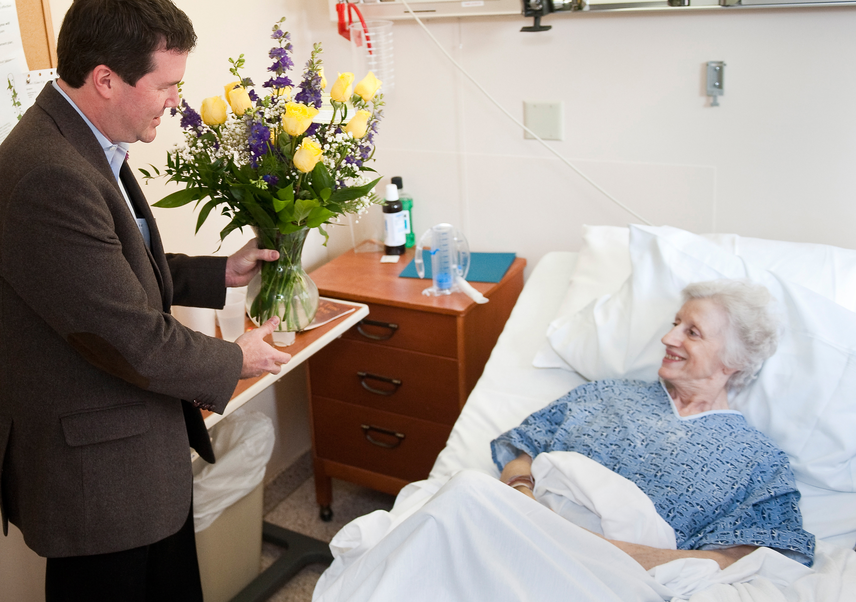 Larsen Jay giving flowers to patient