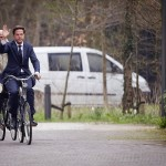 Dutch Prime Minister Mark Rutte (R) and Stef Blok from the People's Party for Freedom and Democracy (VVD) arrive on their bicycles at Catshuis, the official residence of the Prime Minister, in the Hague, on March 29, 2012. AFP PHOTO/ ANP EVERT-JAN DANIELS netherlands out (Photo credit should read Evert-Jan Daniels/AFP/Getty Images)