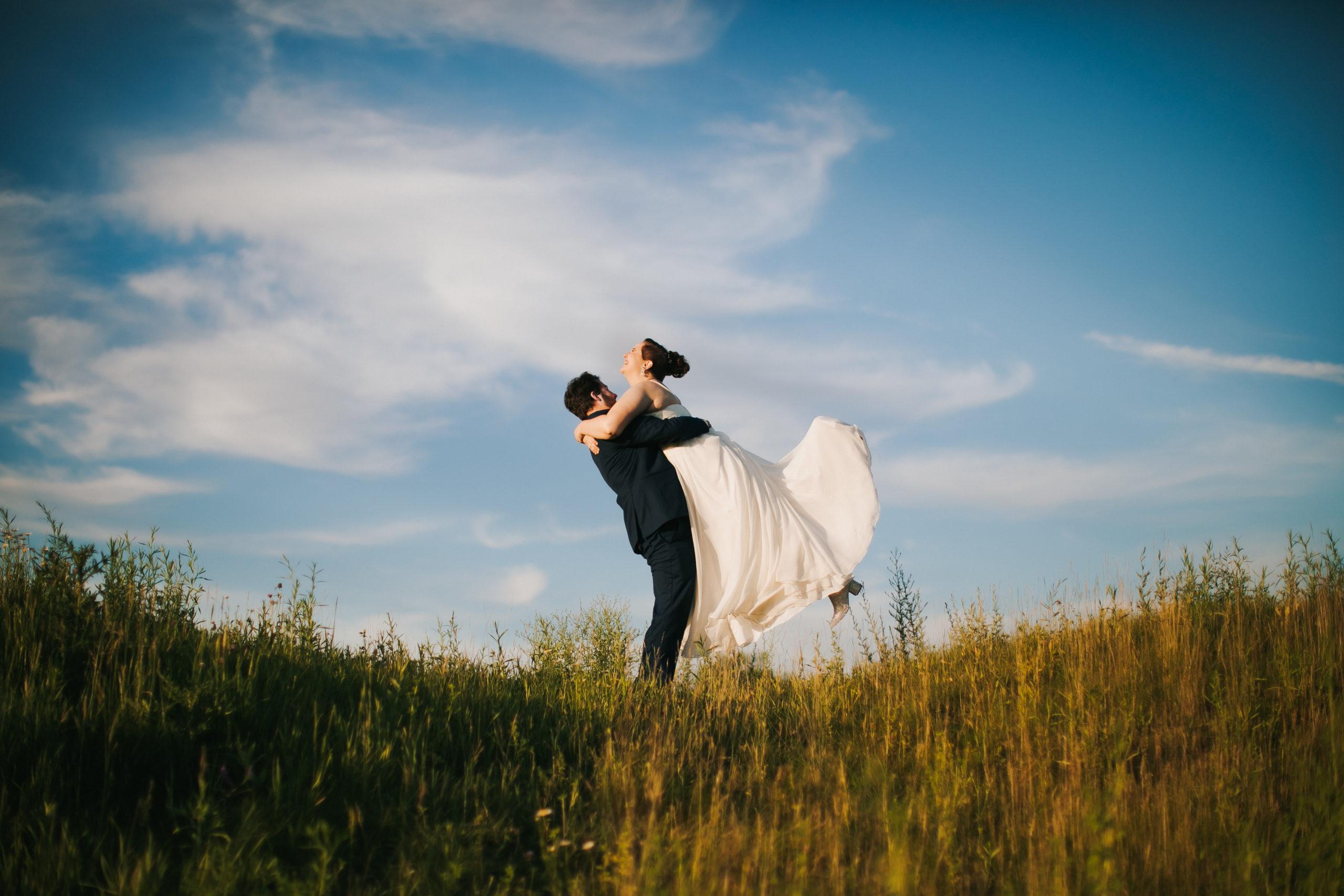 A groom picks up his bride