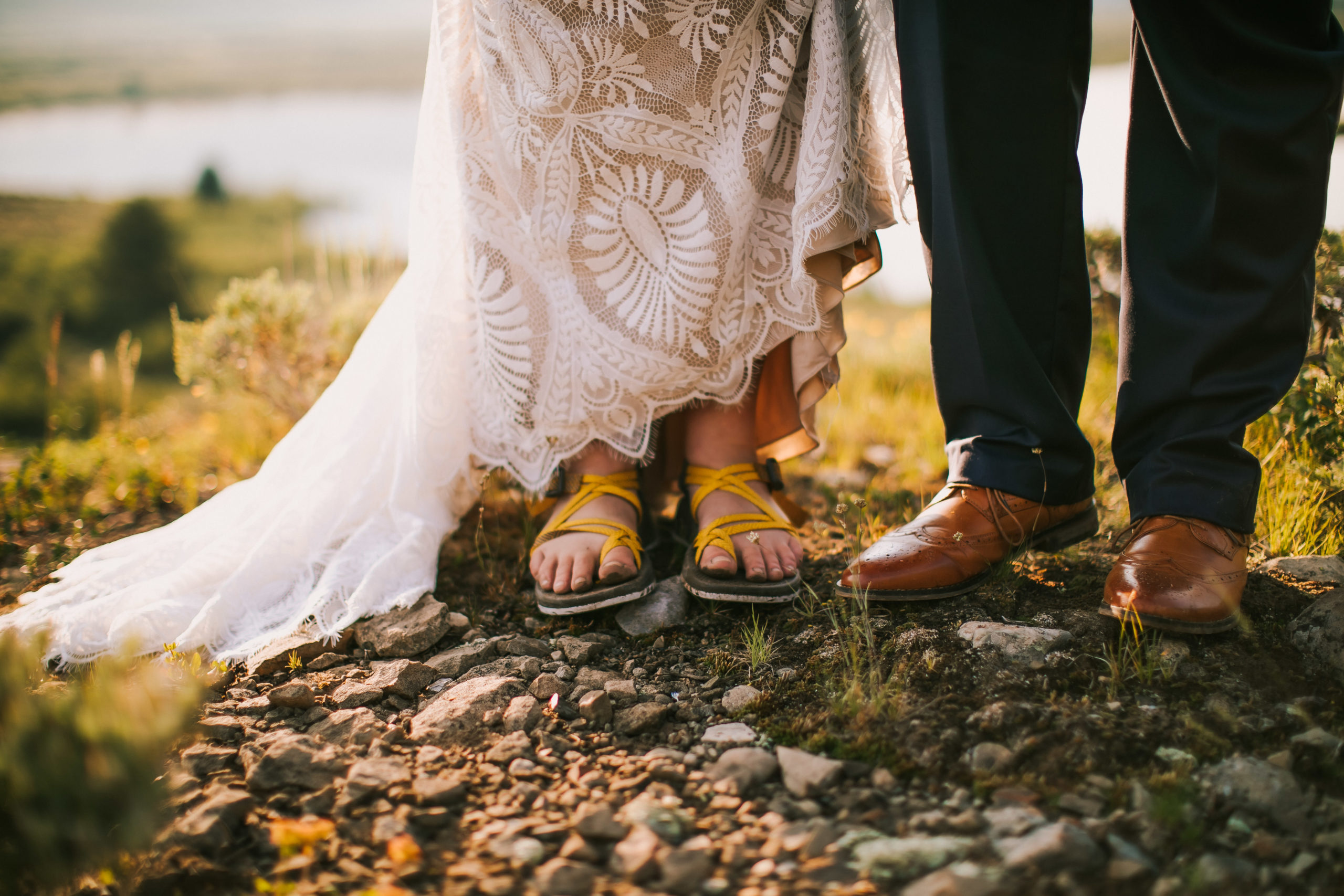 A woman wears Chacos hiking sandals under her wedding dress