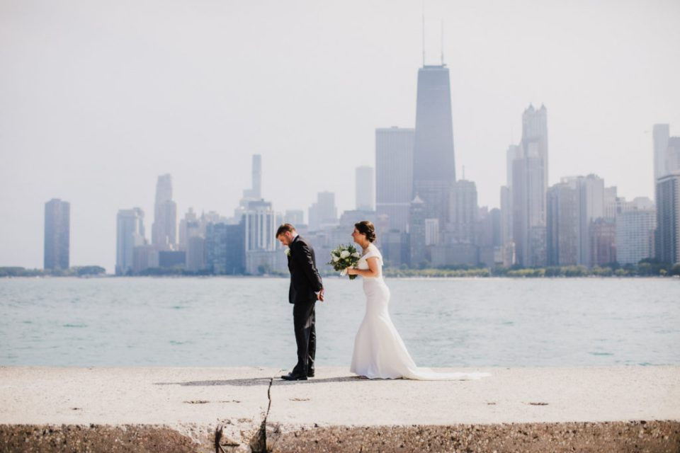 A man and woman share a first look on Hook Pier in Downtown Chicago on their wedding day