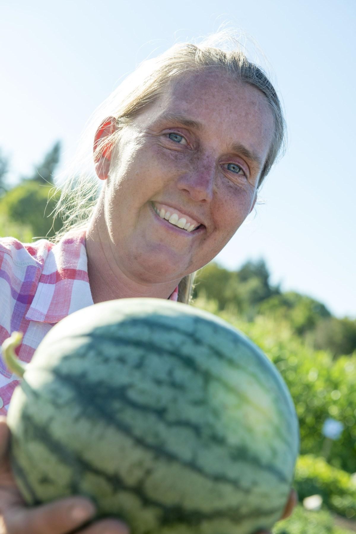 Heidi Noordiik holding a dryland farmed watermelon.
