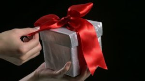 stock-footage-slo-motion-red-ribbon-unwrapped-from-present