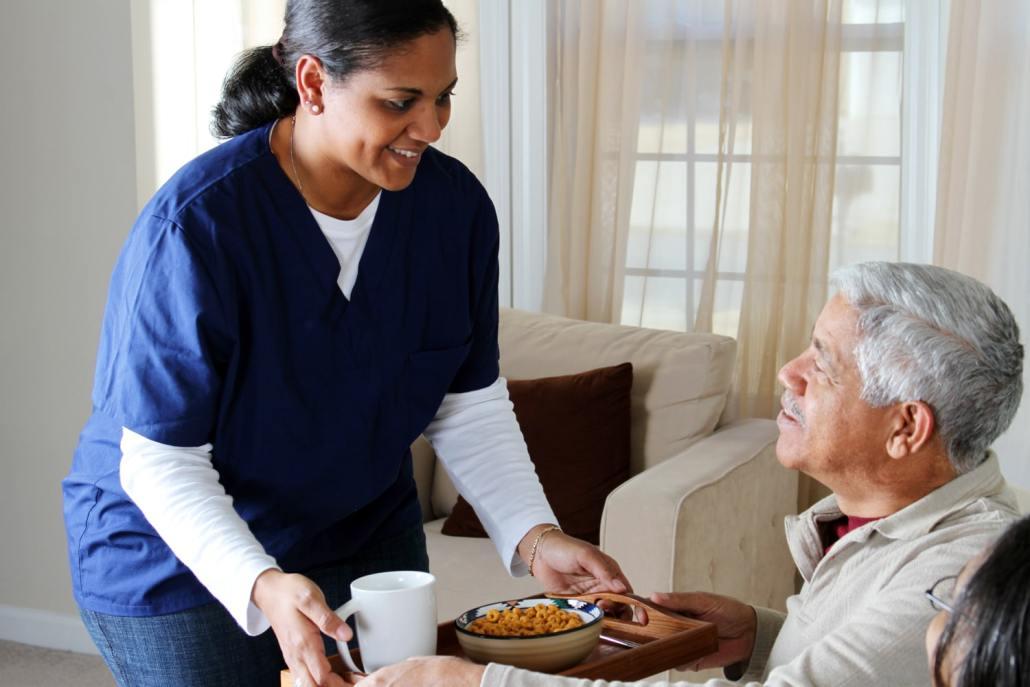 caregiver delivering food to a senior
