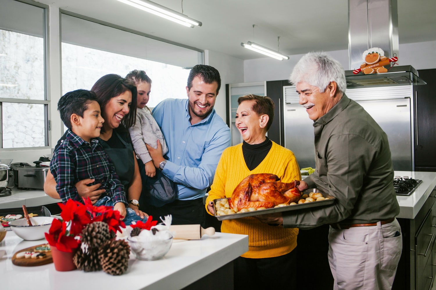 happy multigenerational family with turkey dinner