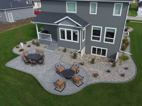 gray paver patio with edging rocks