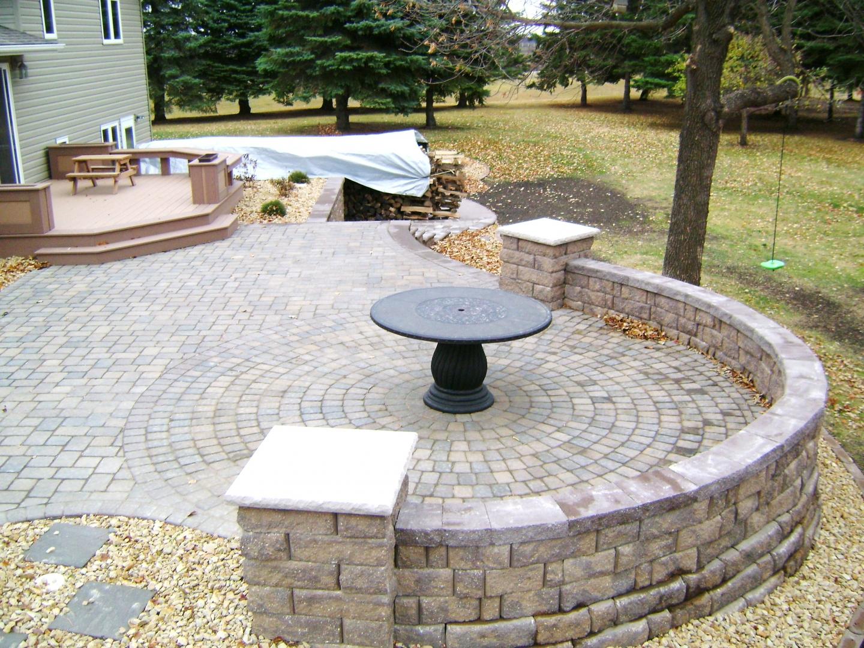 raised paver patio with retaining walls