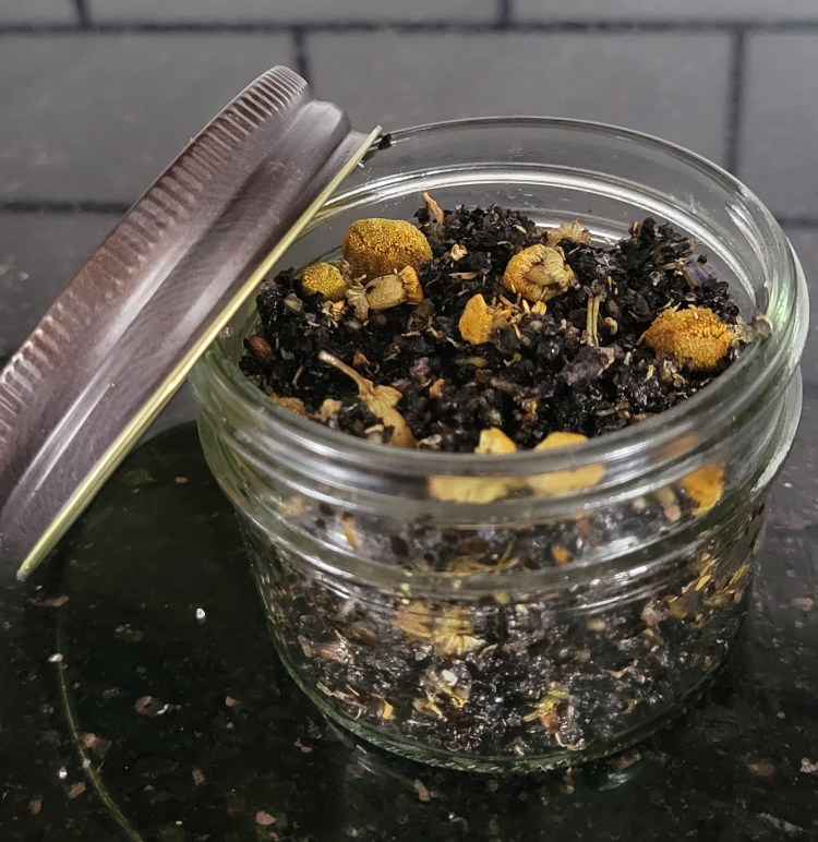A Mason Jar of DIY Coffee Ground Body Scrub