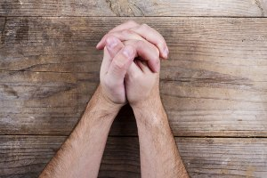 Hands folded in contemplation or prayer