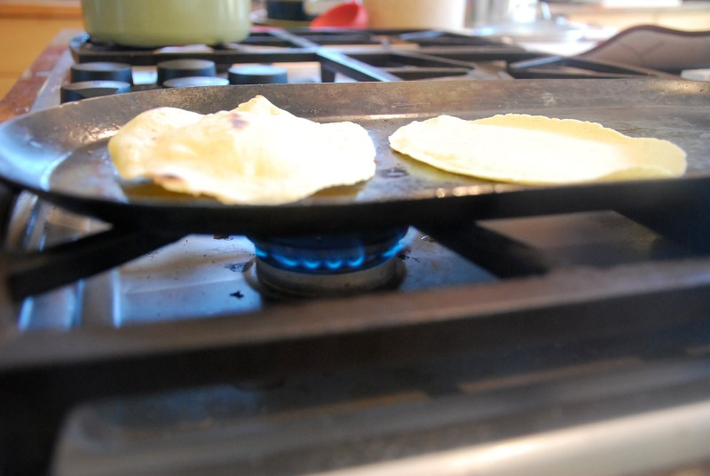 Cook tortilla until it begins to puff, turning 3x