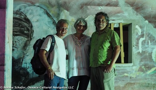 David, Carol and Gabo in the textured courtyard wall glow
