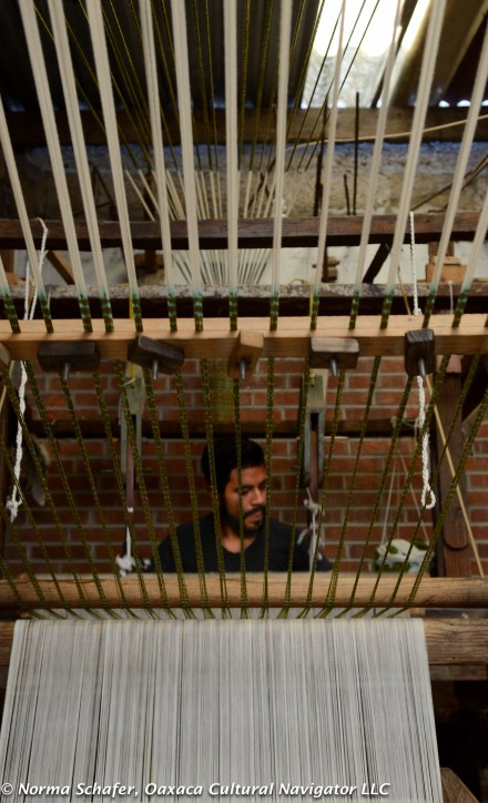 Son Hugo weaves at pedal loom