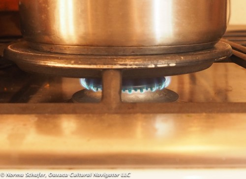 The lowest flame on my stove. Note the heat diffuser.
