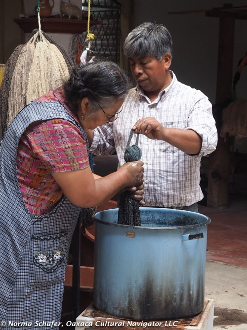 Dolores and Federico work together to dye the yarn to prepare it for weaving