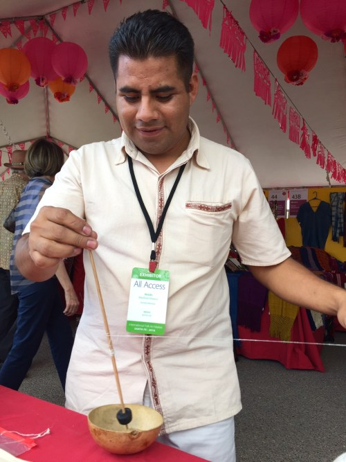 Moises demonstrates silk spinning with drop spindle