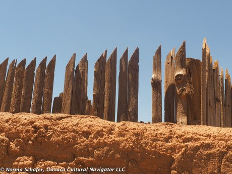 Stockade fence, adobe wall, unresistable texture