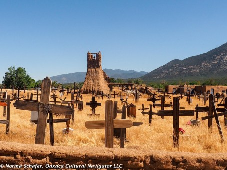 Cemetery, Taos Pueblo, with adobe chapel