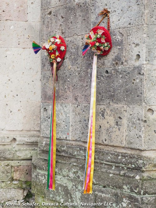 Caps with ribbon tassels, decorated with flowers, worn by Voladores