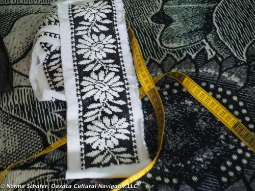 A bodice strip of black and white daisies before the dressmaking begins.