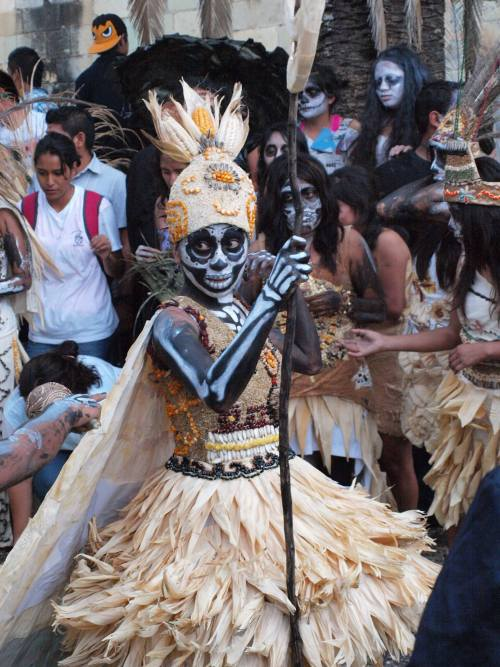 Oaxaca Bachillerato Comparsa (parade) 2013. Her costume is embellished with natural plant materials. By Diane Hobbs