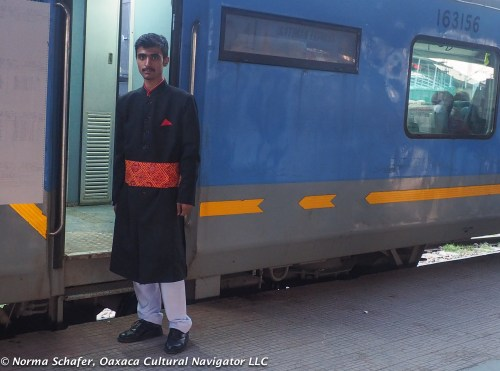 Attendant on the Gatiman Express, fast train between Agra and Delhi.