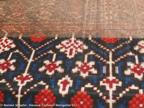 Patola ikat in natural dyes of indigo and cochineal on the loom