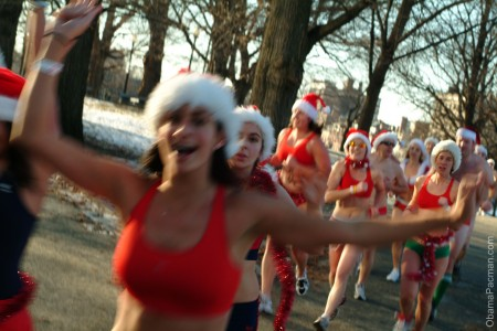 Christmas, joggers wearing santa hats, bikinis, and swimsuits running in wintry Boston Common park, 4152