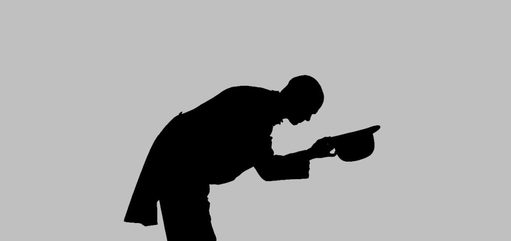 Sylwetka mężczyzny kłaniającego się z atencją