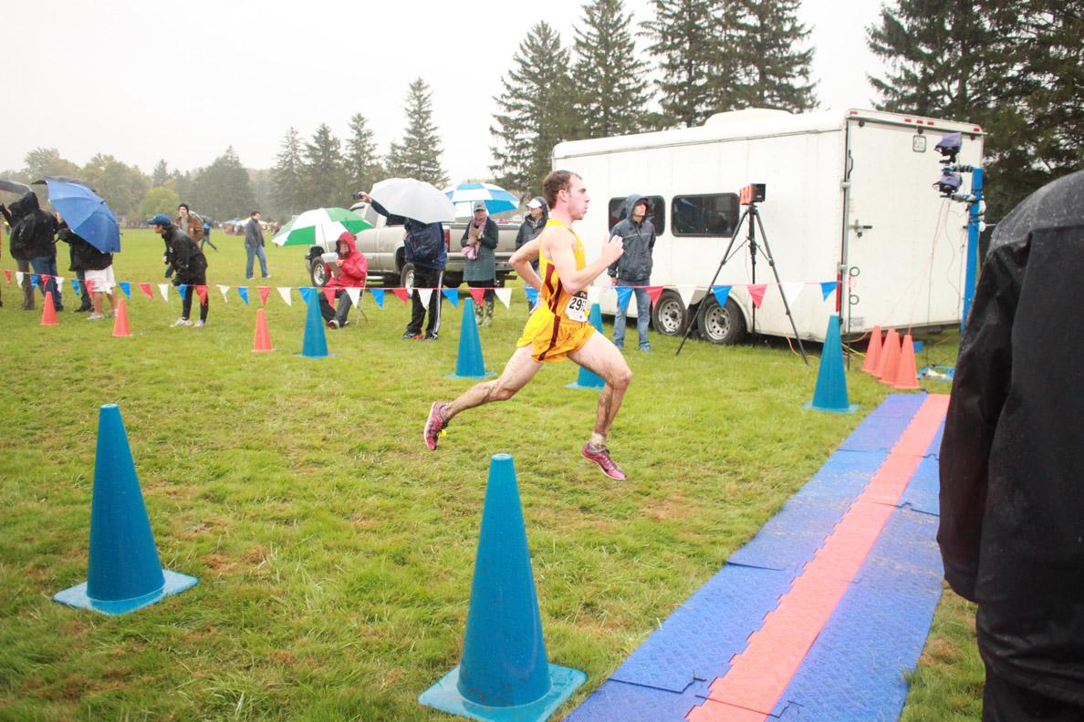 Sophomore Joshua Urso cross the finish line at the Inter-Regional Rumble on Oct. 19. He finished 29th out of 288 runners in the men's varsity 8K.