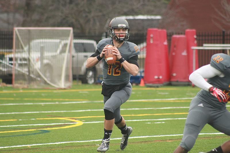 Junior+quarterback+Lucas+Poggiali+looks+downfield+in+a+game+against+the+Ohio+Wesleyan+University+Battling+Bishops+on+Nov.+8.+The+football+team+concluded+its+season+last+weekend+with+a+loss+against+the+Hiram+College+Terriers%2C+finishing+with+an+overall+record+of+2%E2%80%938.