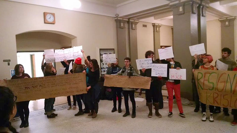 Students+hold+signs+expressing+a+variety+of+demands+outside+Friday%E2%80%99s+trustee+dinner%2C+including+what+many+idenify+as+the+College%E2%80%99s+complicity+in+the+systemic+oppression+of+people+of+color.+This+week%2C+some+are+pressuring+the+administration+to+temporarily+suspend+the+standard+grading+system+in+the+wake+of+nationwide+protests+and+conflict+following+the+deaths+of+Michael+Brown%2C+Eric+Garner+and+Tamir+Rice.