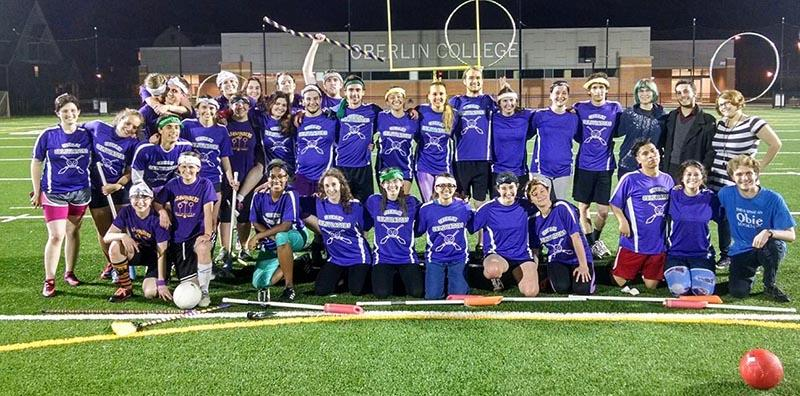 The+quidditch+team+poses+for+a+celebratory+photo+after+defeating+Ashland+University+in+its+first-ever+home+game+at+the+Austin+E.+Knowlton+Athletic+Complex+last+Friday.+Quidditch+officially+became+a+club+sport+earlier+this+semester.