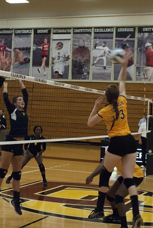 Sophomore+Claudia+Scott+spikes+the+ball+against+the+University+of+Michigan-Dearborn.+The+Yeowomen+fell+to+the+Wolverines+on+Tuesday.