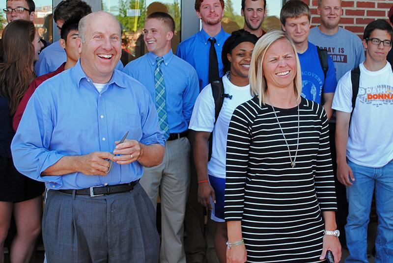 College+President+Marvin+Krislov+%28left%29+and+Natalie+Winkelfoos+share+a+laugh+outside+the+Austin+E.+Knowlton+Athletic+Complex.+This+summer%2C+the+NCAC+elected+Krislov+as+Conference+president+and+the+NACWAA+awarded+Winkelfoos+Administrator+of+the+Year+for+Division+III+Athletics.