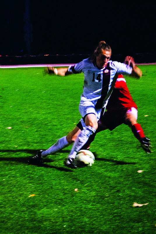 Junior forward Sam Weiss dribbles past a Little Giant of Wabash College on Saturday, Oct. 20. The Yeomen concluded their regular season with a record of 11–7–1.