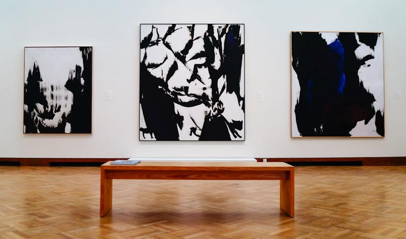 "Works by Judit Reigl. LEFT: ""Mass Writing,"" 1965. Oil on canvas. JRZA Trust, New York. CENTER: ""Man,"" 1966. Oil on canvas. Lent by The Metropolitan Museum of Art, Purchase, Lila Acheson Wallace Gift, 2009 (2009.146). RIGHT: ""Mass Writing,"" 1961. Oil on canvas. Collection of the artist."
