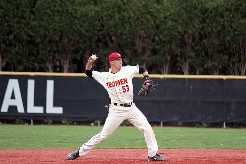 First-year+shortstop+Ian+Dinsmore+throws+to+first+in+the+Yeomen%E2%80%99s+home+opener+Wednesday.+Dinsmore+delivered+a+two-out+RBI+single+in+the+bottom+of+the+ninth+to+give+Oberlin+the+win%2C+defeating+John+Carroll+University+9%E2%80%938.+The+Yeomen+are+currently+8%E2%80%9311+overall+this+season+and+will+be+back+on+the+field+April+9+to+host+the+Hiram+College+Terriers.