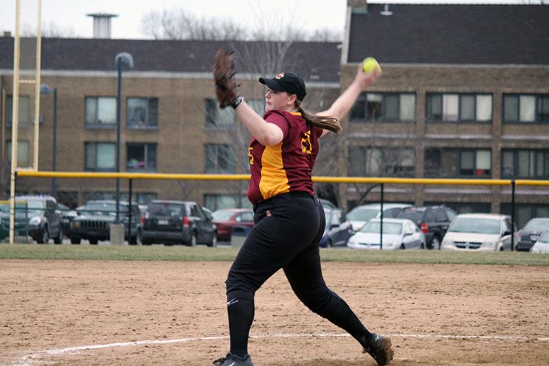 First-year+pitcher+Hannah+Rasmussen+delivers+a+pitch+to+her+Ursuline+College+opponent+March+9+in+Pepper+Pike%2C+Ohio.+The+Yeowomen+split+their+doubleheader+Wednesday+with+the+Allegheny+College+Gators%2C+earning+their+first+conference+win+of+the+season.+
