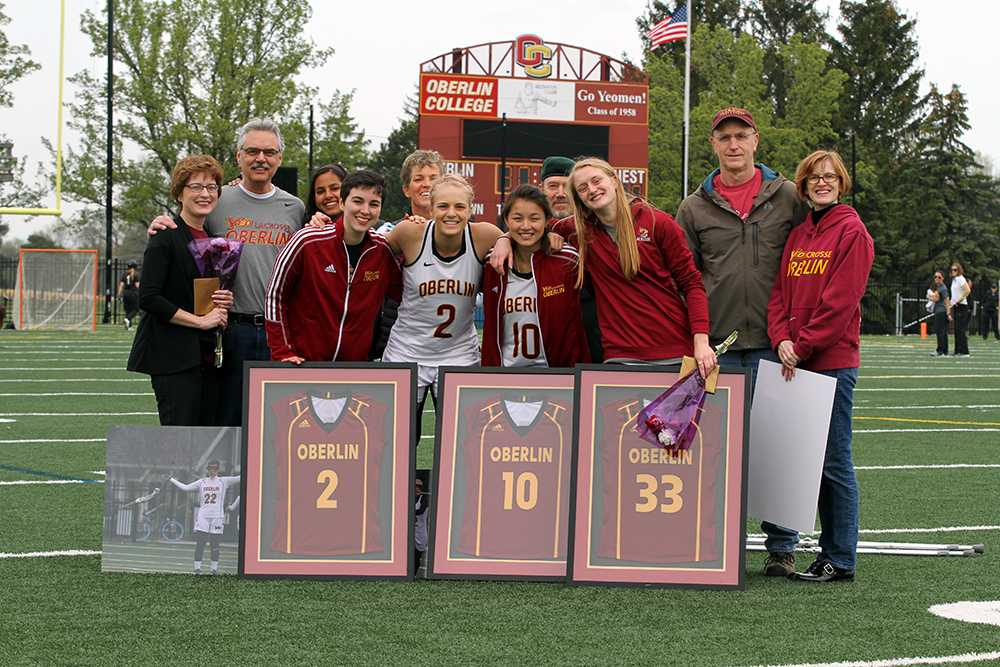 Seniors Emily Kipling, Taylor Swift, Suzanna Doak and Grace Barlow stand with their families during the women's lacrosse team's Senior Day celebration. The Yeowomen ended their season Saturday, losing a nail-biter to The College of Wooster 14–13.