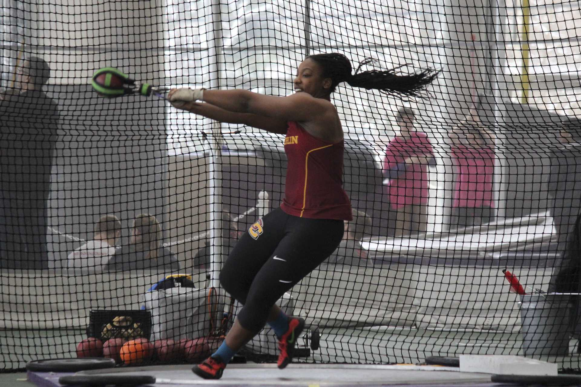 Junior thrower and three-time All-American Monique Newton launches the shot put. A Sacramento, CA native, Newton is also a track and field team captain.