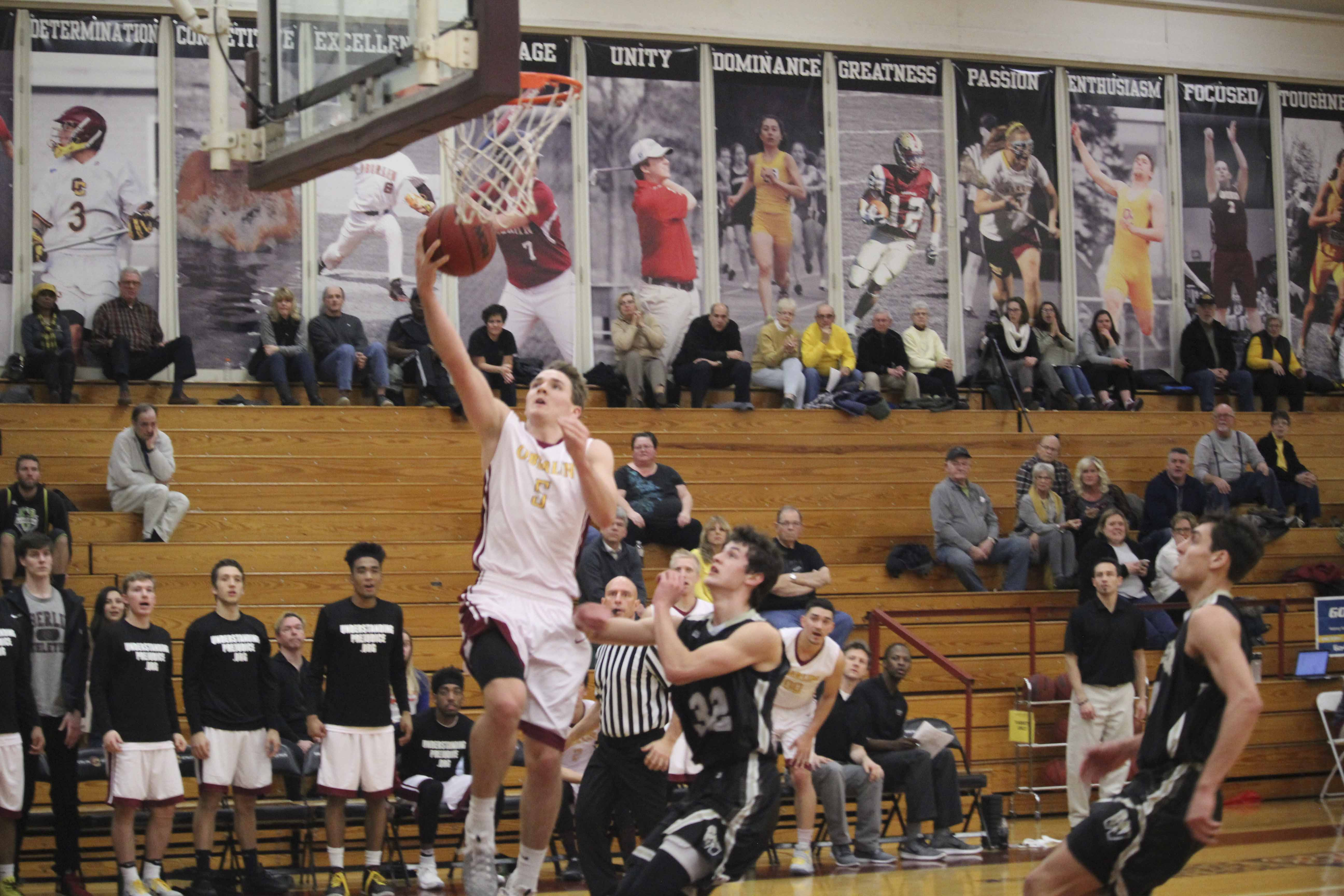 Senior Jack Poyle leaps for a layup in Oberlin's 69–68 loss against The College of Wooster Wednesday night.