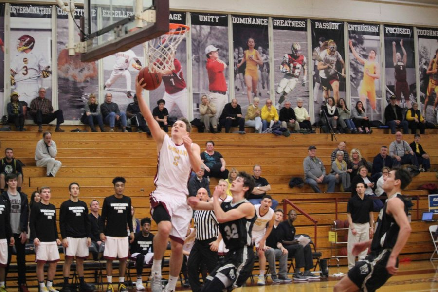 Senior+Jack+Poyle+leaps+for+a+layup+in+Oberlin%E2%80%99s+69%E2%80%9368+loss+against+The+College+of+Wooster+Wednesday+night.+