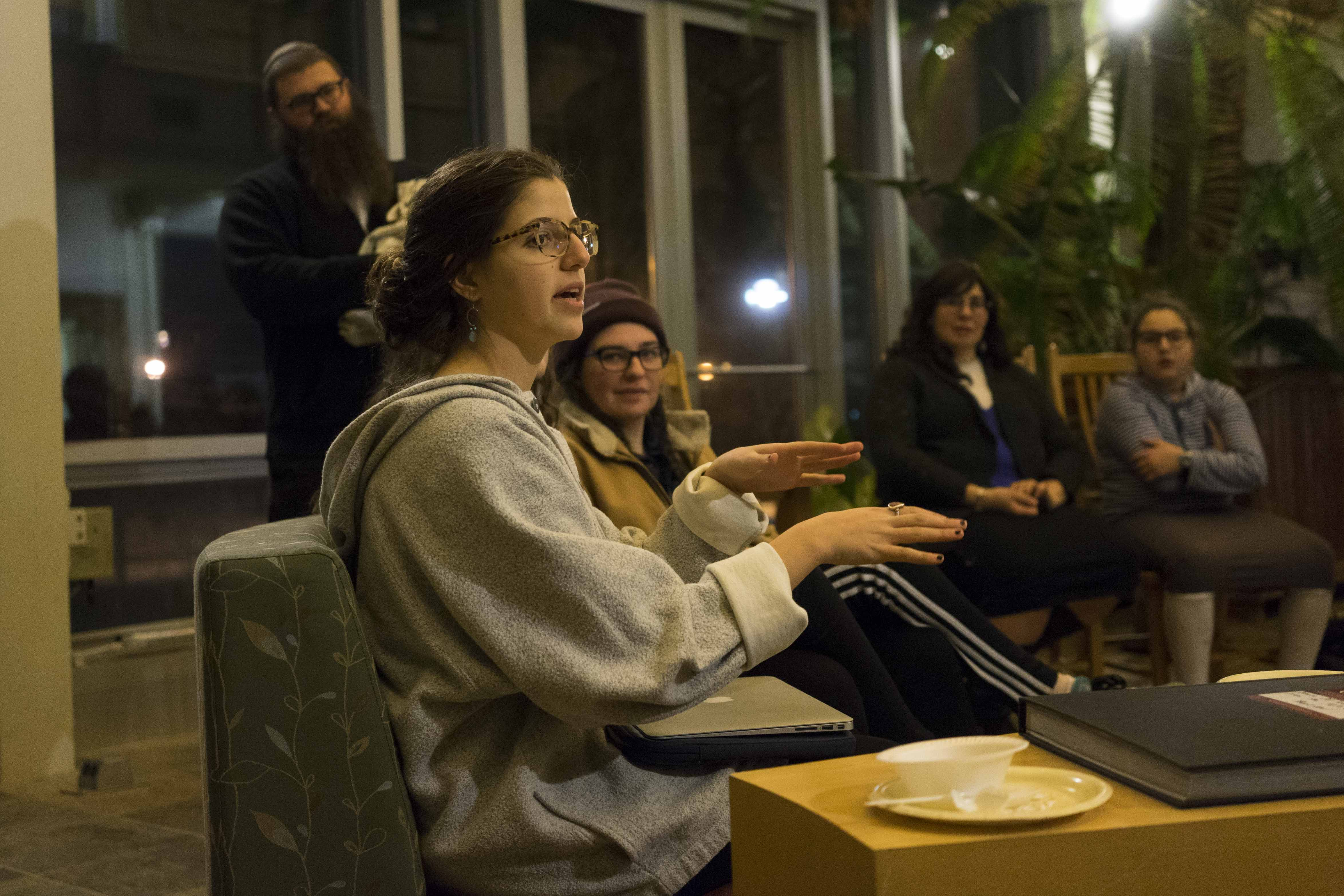 "College senior Isabelle Harari speaks at ""Roots: Exploring Jewish Identity Through Family Stories & Culinary Traditions,"" an event Wednesday put on as part of the ""How Do You Jew?"" series."