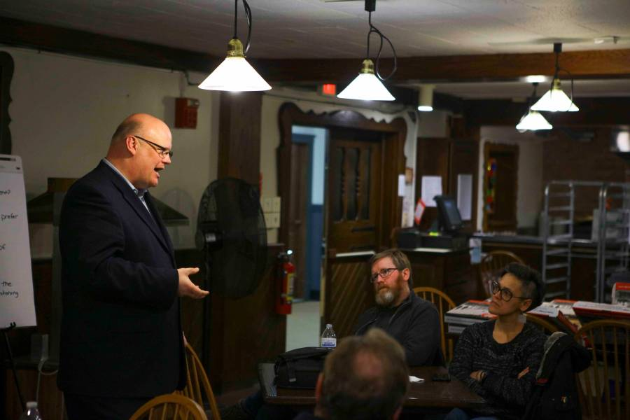 City+Manager+Rob+Hillard+holds+a+listening+session+with+community+members+and+students+at+the+Rathskeller+Monday+evening+as+the+search+for+the+new+police+chief+continues.+The+attendees+emphasized+that+the+new+chief+should+prioritize+residents%27+well-being.