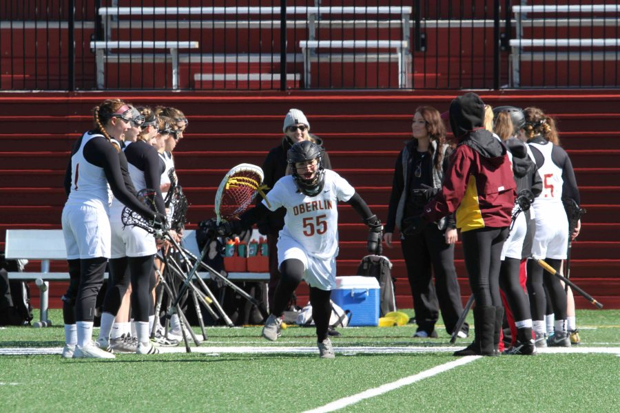 Sophomore+goalie+Siena+Marcelle+runs+through+a+tunnel+of+teammates+onto+the+field+in+Oberlin%E2%80%99s+home+opener+against+Kalamazoo+College+March+4.+The+Yeowomen+will+continue+conference+play+when+they+travel+to+take+on+Ohio+Wesleyan+University+at+1+p.m.+tomorrow.