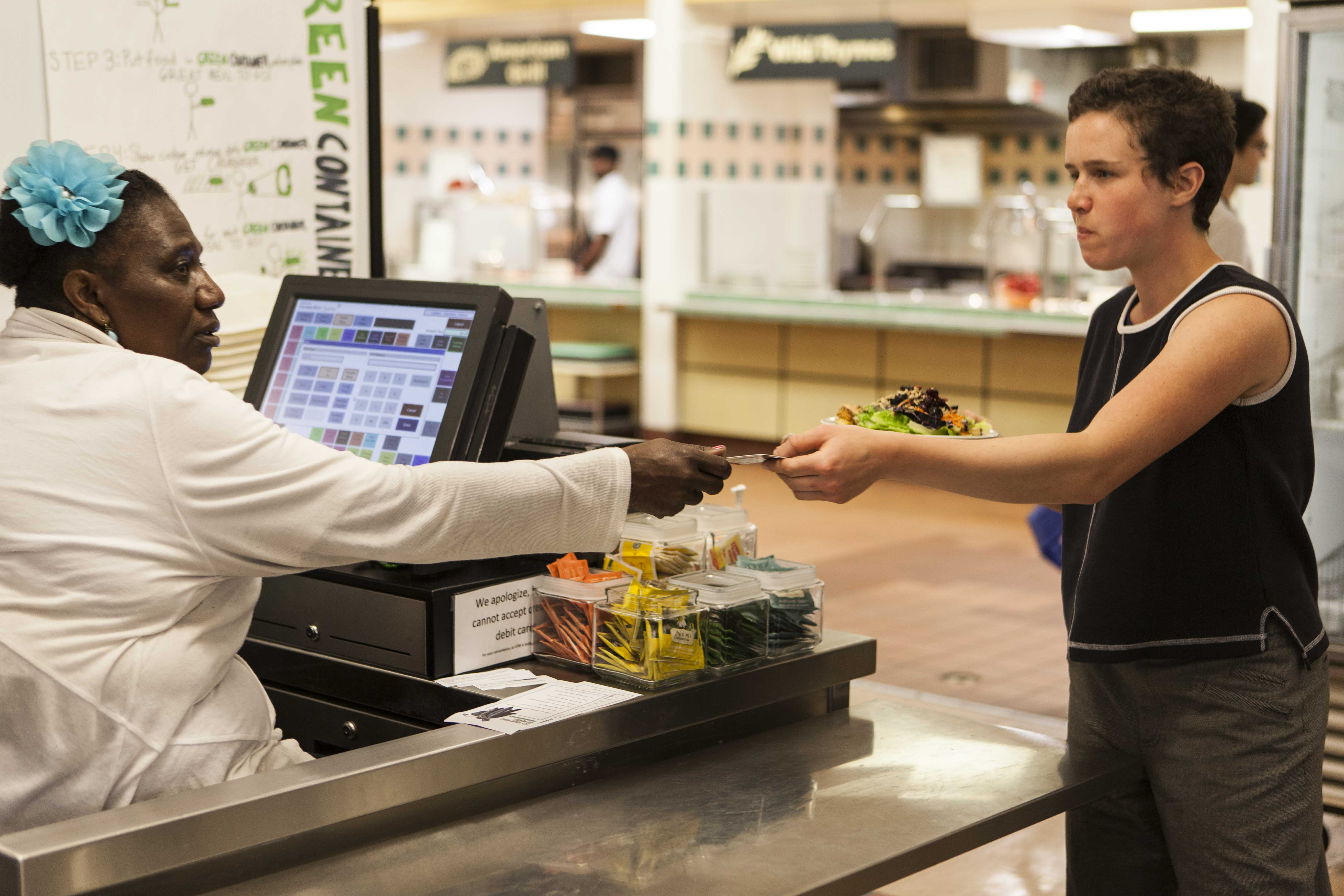 College junior Hannah Sklar uses a meal swipe in Dascomb Dining Hall. Starting next semester, all first-years will be required to have a 300-meal-per-semester dining plan, unless they choose to eat in OSCA.