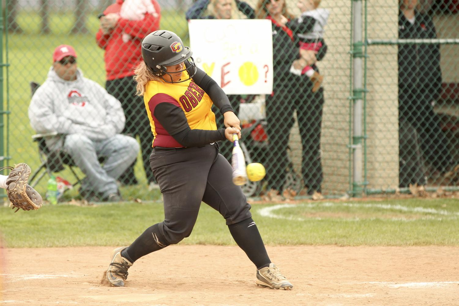 Senior captain Grace Evans connects with a pitch against Wittenberg University on Senior Day last Saturday. The Yeowomen finished their season 12–28 overall and 2–14 in the NCAC.